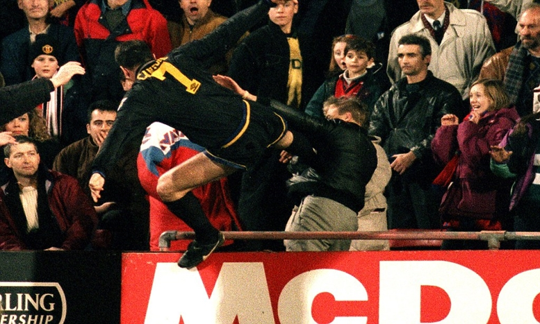 Crystal Palace v Manchester United 25/1/95 F.A Premier League  Mandatory Credit : Action Images   Man Utd's Eric Cantona jumps into the crowd with his infamous Kung-Fu kick on a Palace supporter after being sent-off